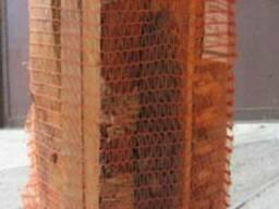 Древесные заготовки в сетках, дрова
