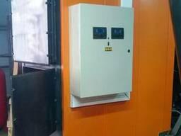 Твердотопливный котел с автоматической подачей топлива IGNIS