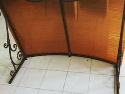 Козырёк кованый над входом с элементами ковки