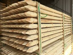 Machine-rounded poles from pine wood