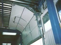 Промышленные секционные ворота купить - фото 2