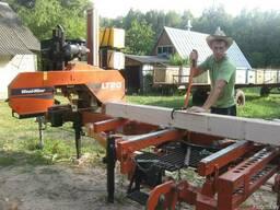 Распиловка древесины на дизельной пилораме Woodmizer